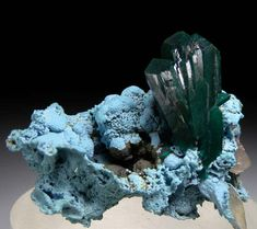 Dioptase on Shattuckite, Kaokaveld, Namibia. Colorful specimen of thick Dioptase cluster on blue Shattuckite. Size 5 x 3.5 x 3 cm