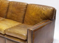 Looking damn good at 80 years old!  1930's  Leather Sofa . Nail head Trim.