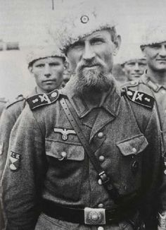 Russian Cossack Wehrmacht volunteer.  I wonder if that breast eagle was sewn backwards on purpose..