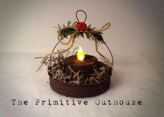 Primitive Handmade Christmas ornaments out of painted canning lids with battery tealight Primitive Christmas Ornaments, Prim Christmas, Handmade Ornaments, Diy Christmas Ornaments, Homemade Christmas, Winter Christmas, Christmas Decorations, Ornaments Ideas, Cowboy Christmas