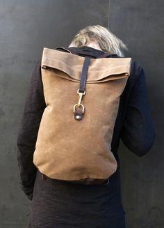 Waxed canvas postal backpack. Waterproof. Brass hardware.