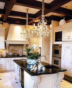 What a statement these chandeliers make! Always add plants... orchids are one of my favorites!