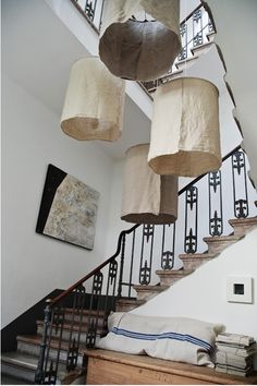 We like this concept: oversized lanterns with rustic raw linen shades, spotted in an Italian interior designed by Orietta Marcon. The Lampade Bigger by Vic