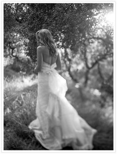 bridal portrait showing back of dress - love the artsy, whimsical feel of this picture