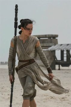 Daisy Ridley in Star Wars: The Force Awakens  has anyone realized that the ends of this pole look like lightsabers.....????