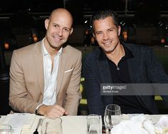 GQ's Chris Mitchell (L) and actor Timothy Olyphant attend the Audi and GQ Men Of The Year Dinner