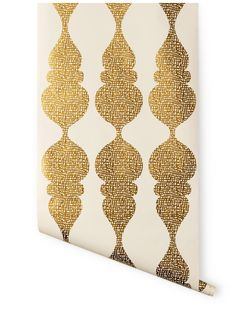 Terrance Payne Wallpaper for Hygge & West | Carved Ogee (Gold/White). This would make for a great accent wall to add some elegant drama to a room.