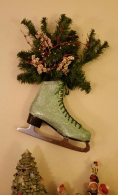 Took an old ice skate, painted and glittered it up... A cute decoration for wintertime...