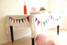 Cute bunting tablecloth.