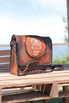 Skull; handtooled leather bag