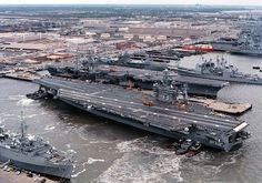 USS George Washington (CVN 73), with her crew manning the rails, pulls into pier 11 north at Norfolk Naval Base, March 8, 1997. Commanded by CAPT Malcolm P. Branch, George Washington was returning from post-shipyard sea trials. USS Dwight Eisenhower sits in the background undergoing overhaul. U.S. Navy Photo By Photographer's Mate 2nd Class Christopher Vickers (# 970308-N-2381V-001).
