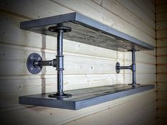Wooden shelf, Wall shelf, Wall bookshelf made out of solid pine wood and industrial pipe. Pipe and fittings are fully degreased and covered with several layers of mat lacquer to maintain their look and stop from smear. Pine wood is stained and covered with wax. Shelf depth - 10 /