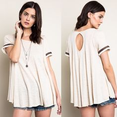 Trapeze Tribal Accent Tee / Top Trapeze tee with a keyhole back and tribal sleeve accents. Available in sky and cream. This listing is for the CREAM. Brand new. Runs large. NO TRADES DON'T ASK. Bare Anthology Tops Tees - Short Sleeve