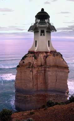 lighthouse- I don't know where it is, but I am intrigued by it! I am trying to decide if it is actually the Cape Reinga Lighthouse in New Zealand (minus the rock of course. Beacon Lighting, Beacon Of Light, Saint Mathieu, Lighthouse Pictures, Light Of The World, Belle Photo, Architecture, Beautiful Places, Wonderful Places