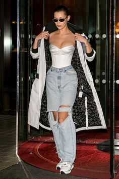 Bella Hadid slips into vintage corset and ripped jeans for PFW All eyes on her: Bella pulled the collar of her coat towards her as she stepped out sporti.All eyes on her: Bella pulled the collar of her coat towards her as she stepped out sporti. Mode Outfits, Trendy Outfits, Fashion Outfits, Womens Fashion, White Outfits, Woman Outfits, Hijab Fashion, Bella Hadid Outfits, Bella Hadid Style