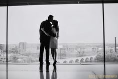 silhouettes at guthrie theater minneapolis wedding photographer engagement photos at stone arch bridge in winter - cute and simple stripes + suit - Becca Dilley Photography, Minneapolis Wedding Photographer