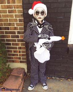 My 7 year old son in his Jack Skellington costume for the kids contest. He's wearing a thrift costume suit that I altered and sewed to resemble a tuxedo with tails, like Jack's. I crafted and sewed his bat bowtie and we added the gloves. Halloween Costume Contest, Family Halloween Costumes, Halloween Kostüm, Halloween Cosplay, Jack Skellington Costume Kids, Jack Skellington Kürbis, Best Baby Costumes, Boy Costumes, Whimsical Halloween