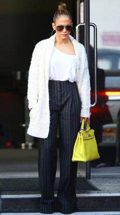 Jennifer Lopez in a white top, cardigan and high-waisted black pants