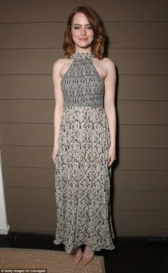 Simply stylish:Emma Stone, 28, looked chic in a whimsical printed dress at a special screening of her hotly-tipped romantic musical La La Land in Los Angeles on Monday