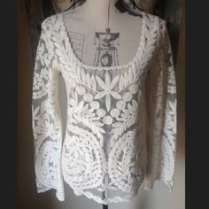 NWT Anthropologie..staring at stars embroidered Stags still attached.. Never worn.. Embroidered long sleeve is 100% polyester and embroidery 100% cotton.. Smoke free and pet free home.. Bundle your order and save 20%!! Staring at Stars Tops