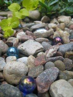 Garden Details: Marvelous Marbles That would be pretty to have out in the rock piles.