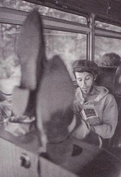 Tom Waits on the tour bus reading 'Last Exit to Brooklyn', 1975. Photo by Michael Dobo