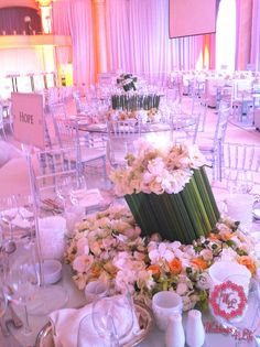Dreamy white wedding. Modern setup. Low centerpiece with bamboo. White and Plexiglas Tiffany Chairs
