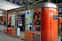 """Moleskine's first stand-alone store in the States opened today at the Time Warner Center in Columbus Circle. Straddling the line between """"large kiosk"""" and """"intimate shop,"""" the ovular orange stall stocks more than just the namesake notebooks."""