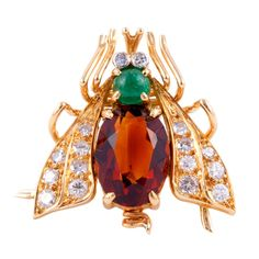 VAN CLEEF and ARPELS 18KT yellow gold, diamond, cabochon emerald and citrine fly pin. French Hallmarks. 1980