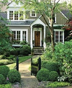 inviting curbside landscaping + love the gate