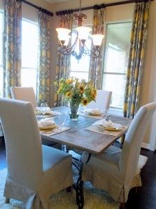 love the curtains almost to the ceiling yellow + gray dining room.