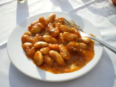 Healthy, full of fiber and filling, gigantes plaki (γίγαντες πλακί), is a common mezze all over Greece. Gigantes, or giant white beans, are slow-baked in a tomatoey sauce until they are creamy and caramelized. The beans — also called gigandes, yigandes, elephant beans or butter beans — can be substituted with lima beans. The Turkish version uses red beans. 6 to 8 servings