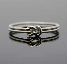 Hug Infinity ring. Sterling Silver knot ring  Nautical ring Promise ring Purity ring sailor knot. $38.00, via Etsy.