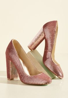 If you've been searching for glam heels for far too long, open your eyes! These quartz pink pumps by Blue by Betsey Johnson are right in front you! Coated in a shell of glitzy sequins and polished with satin trim, these statement kicks are a noteworthy discovery full of high-impact design.
