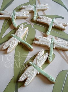 Dragonfly decorated sugar cookies. Royal icing. White, green.