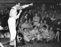 Basil Rathbone entertaining the troops at the Hollywood Canteen.