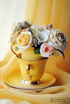 yellow cups, flower in cup and saucers