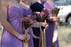 Purple bridesmaid dresses with a touch of gold