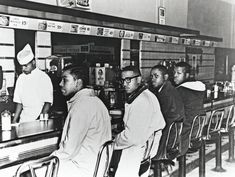 Greensboro Four, who, as freshmen at the North Carolina Agricultural and Technical College, staged a sit-in at the whites-only lunch counter at a Woolworth's in Greensboro, in February, 1960. Hundreds of people joined the protest, and sit-ins and boycotts were held in cities across the country. Six months later, Woolworth's desegregated its counters. Photograph by Jack Moebes / Corbis