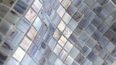 This is a beautiful iridescent glass mosaic in a mix of light blue. Description from tiledaily.com. I searched for this on bing.com/images