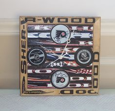 Hockey Puck Clock - you know, put the right team on there first... also love the frame! Used sticks at the second hand store... oh yeah.