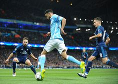 Manchester City defender Gael Clichy (centre) bursts towards Real Madrid's box as Manuel P...