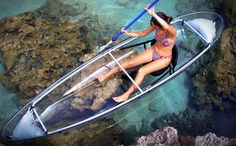 CLEAR CANOE KAYAK -- A diminutive version of the glass-bottom boat reef tour on Key Largo, but in an easier to maneuver form.  It is called a 'canoe kayak' because it is wider like a canoe to displace more water for greater surface stability, and the paddler sits lower to the deck for improved balance.  Overall, this clear watercraft is not only an amazing way to experience the water, but also a cool and sporty gift idea, at just $1,600.
