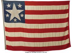 A very  rare Confederate secession Flag- 1861. This is an extremely rare Confederate secession flag, one of only two known to exist. A six-star variant of the Confederate First National flag, this flag was made prior to the adoption of the First National design on March 4, 1861.  It is identical to one at the Florida State Archives.  Heritage Auctions.