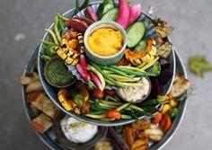 Our friends at Botanica are known for their veggie plateaus—a multicolored jumble of gorgeous seasonal vegetables, prepared every which way, with flavors and textures and dips galore. It's a tower of