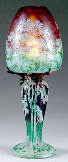 "lighting, France, A Daum Nancy boudoir lamp depicting a wooded landscape scene. Very unusual white, pink, and green enameled and cameo scene on mottled amsthyst and green background. Signed ""Daum Nancy"" Circa 1780-1910"
