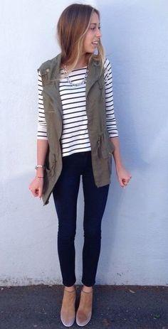 Utility vest, striped long sleeve shirt, black pants