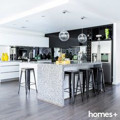 Melissa's #contemporary #kitchen has a #black and #white #colour #scheme mixed with pops of #yellow. As featured in the May 2015 issue of homes+. #benchtop #stools #fridge #glass #pendant #light #tray #splashback #cook #marble #modern #home #style #decor #caesarstone #gloss #pantry #homesplusmag Contemporary Style Homes, Splashback, House And Home Magazine, Stools, Interior Inspiration, Pantry, Kitchen Design, Kitchens, Marble