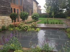 Our Blue Black Slate is very even in colour, creating an elegant feel in any design setting. Slate is best suited for sunny positions as it catches light beautifully, but also looks great in the rain. Slate Paving, Paving Stones, Slate Garden, Stone Patios, Garden Stones, Back Gardens, Pavement, House Front, Fencing