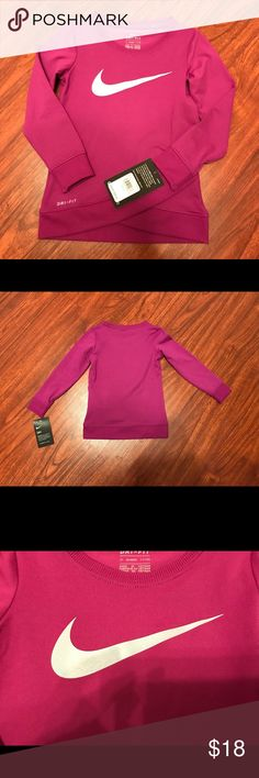 NWT Nike dri fit long sleeve shirt 2T NWT Adorable eggplant colored Nike dri fit long sleeve shirt. Super cute cross cross derail at the bottom hem and sparkly blue swoosh sign on the front.  A must have for winter!  Smoke free home. Put it in a bundle and I'll send you a reasonable offer! Nike Shirts & Tops Tees - Long Sleeve